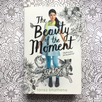 Book 'The Beauty of the Moment' on a sheet of colouring paper